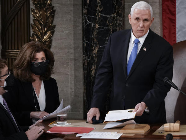 Senate parliamentarian Elizabeth MacDonough works beside then-Vice President Mike Pence earlier this year during the certification of 2020 Electoral College ballots, in the House chamber of the U.S. Capitol.