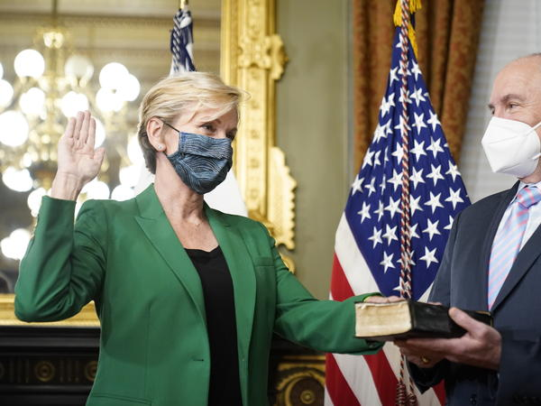 Jennifer Granholm is sworn in as energy secretary Thursday. Granholm told NPR that pivoting to a clean energy economy could ensure a dependable grid and help create jobs.