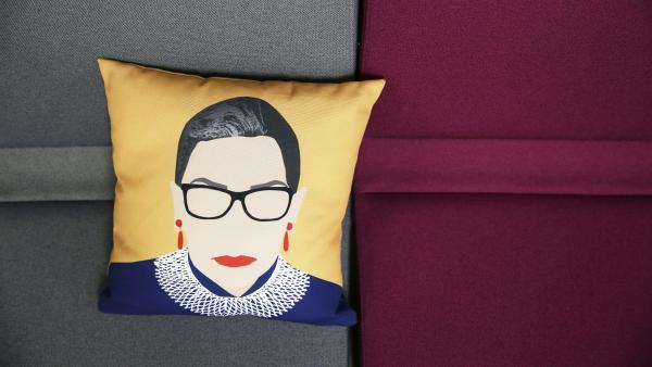 A pillow with Ruth Bader Ginsburg's likeness on it sits on a couch inside the office of ActBlue, a Democratic fundraising platform, in Somerville, Mass.