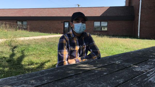 Samuel Gomez sits at the hotel where he and 100 or so other migrant farmworkers are living.
