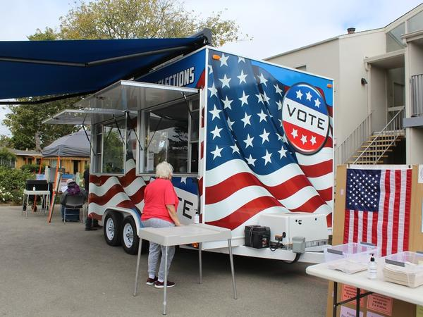 A new mobile voting center brings voting directly to residents in Santa Cruz County, Calif. Here, the VoteMobile is parked at Garfield Park Village, an apartment complex for seniors.