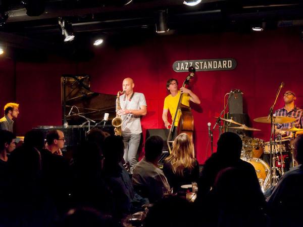 The quartet James Farm (pianist Aaron Parks, saxophonist Joshua Redman, bassist Matt Penman and drummer Eric Harland), playing at New York City's Jazz Standard in 2011.