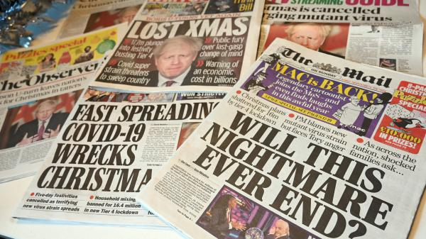 """An assortment of U.K. daily newspapers shows front-page headlines reporting on the tight new coronavirus restrictions for London and the southeast of England, canceling Christmas gatherings for those in the new """"Tier 4"""" category."""