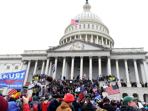 Pro-Trump protesters seeking to force Congress to overturn the election results swarm the U.S. Capitol on Jan. 6, two weeks before President-elect Joe Biden is scheduled to gives his inaugural address there.