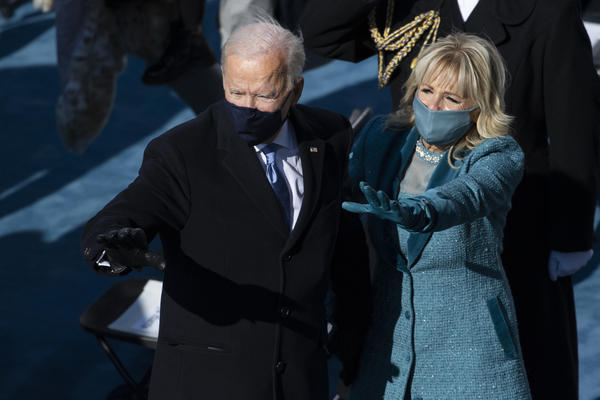 President Biden and first lady Jill Biden wave as they depart from the inaugural stage at the end of the inauguration ceremonies at the U.S. Capitol on Wednesday.