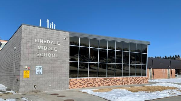 In Wyoming, public schools such as Pinedale's middle school, face significant cuts to their budgets due to slumping oil, gas and coal prices.
