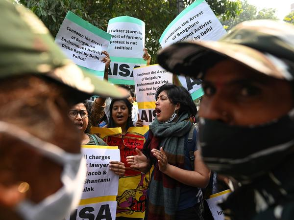 Demonstrators in New Delhi shout slogans during a protest against the arrest of climate change activist Disha Ravi for allegedly helping to create a guide for anti-government farmers protests.