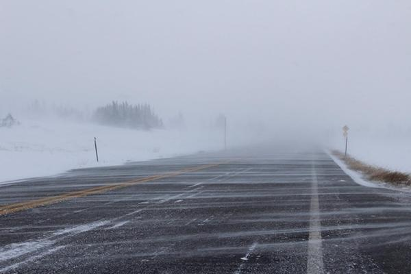Snow blows over a road in southwest Wyoming.