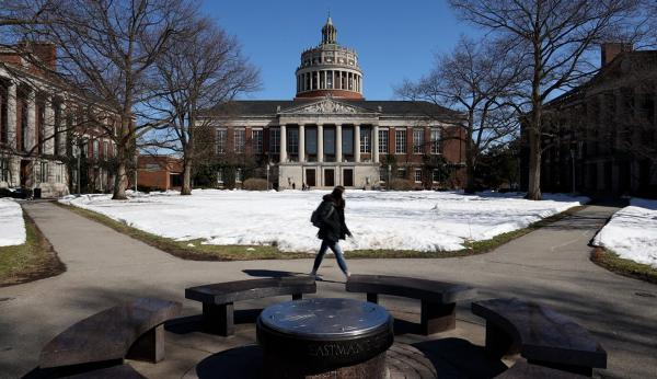 A student on the Eastman Quad at the University of Rochester in Winter 2021.