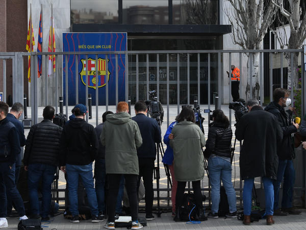 Journalists line the front gate of FC Barcelona offices on Monday during a police operation inside.