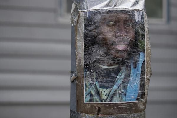 An image of Manuel Ellis is taped to a utility pole on Thursday, June 4, 2020, near the intersection of Ainsworth Avenue South and 96th Street South in Tacoma. Ellis was killed by police on March 3rd, 2020