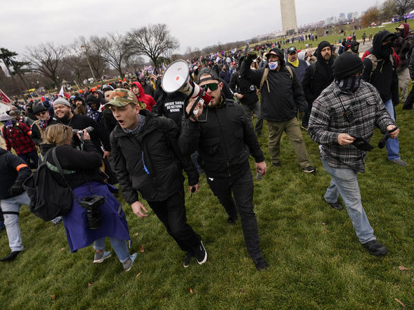 Ethan Nordean, with backward baseball hat and bullhorn, leads members of the far-right group Proud Boys before the riot at the U.S. Capitol on Jan. 6. The self-described sergeant-at-arms of the Seattle Proud Boys is facing federal charges over his role in the attack.