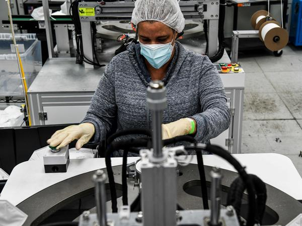 An employee makes respiratory masks in a family-owned medical equipment factory in Miami on Feb. 15. American manufacturers are thriving but they are running into an unexpected problem: finding critical supplies.