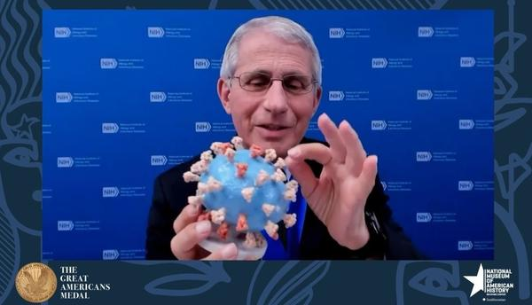 "Dr. Anthony Fauci holds his personal 3D-printed model of the SARS-CoV-2 virion during the ""Great Americans Awards Program."""