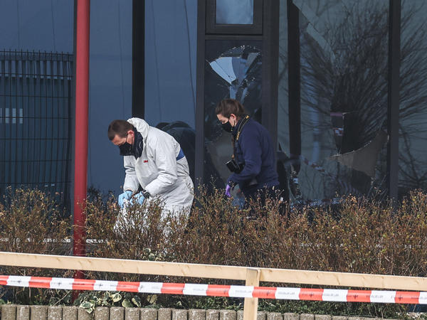 Forensic investigators search for evidence after an explosion on Wednesday at a coronavirus testing center in the town of Bovenkarpsel, The Netherlands.