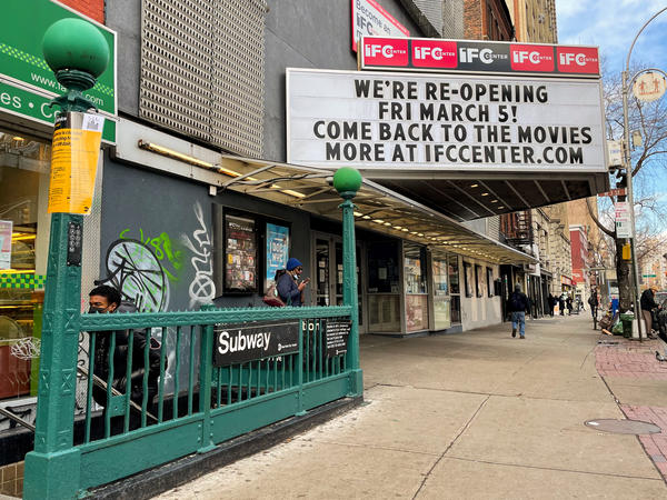The marquee of the IFC Center in Manhattan welcomes viewers back after being closed nearly one year