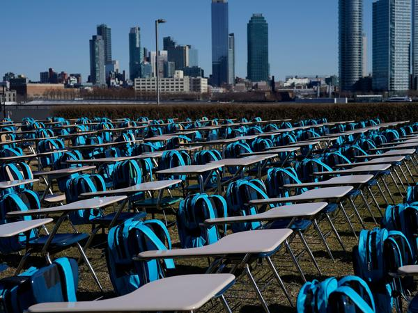 "School desks make up an exhibit called ""Pandemic Classroom"" at the United Nations in New York City. Each of the 168 seats represents 1 million children living in countries where schools have been entirely closed almost a year."