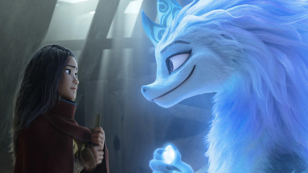 Raya, a young warrior princess (Kelly Marie Tran), enlists the help of Sisu, a friendly water dragon (Awkwafina) in <em>Raya and the Last Dragon. </em>