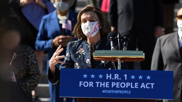 """Speaker of the House Nancy Pelosi, D-Calif., speaks at an event on the steps of the U.S. Capitol for the """"For The People Act of 2021"""" on Wednesday."""
