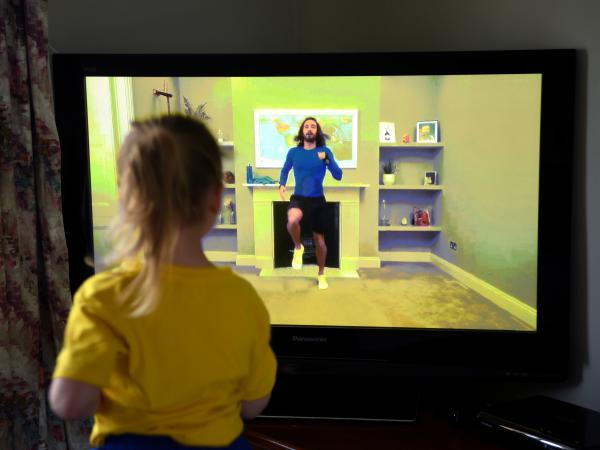 "Four-year-old Lois Copley-Jones, the photographer's daughter, takes part in a livestreamed broadcast of ""PE With Joe"" on March 23, 2020, in Newcastle-under-Lyme, England. The popular fitness series ended Friday."