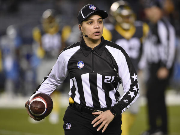 Maia Chaka, shown here officiating an Alliance of American Football game in 2019, has been named the NFL's first Black female official.