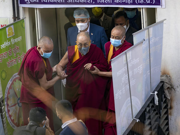The Dalai Lama leaves the Zonal Hospital in Dharmsala, India, on Saturday after receiving the COVID-19 vaccine.