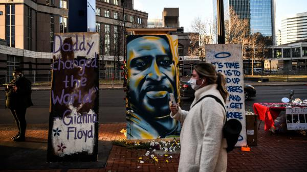 Hennepin County Judge Peter Cahill sent potential jurors in Derek Chauvin's trial home on Monday. Here, a painting of Floyd is seen outside the Hennepin County Government Center, where the trial is taking place.