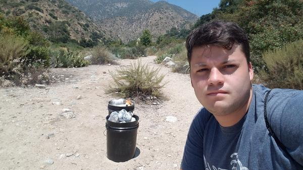 Edgar McGregor, with some of the debris he's collected from Eaton Canyon, part of the Angeles National Forest in Southern California.
