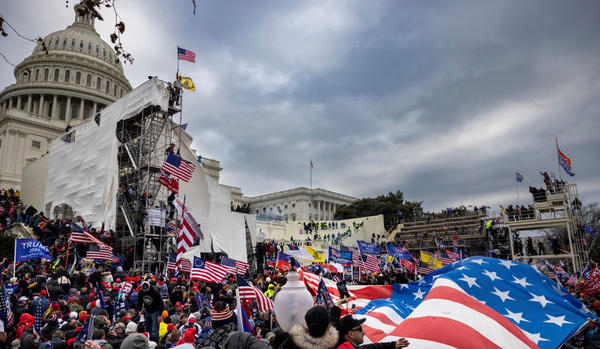 Rioters storm the Capitol on Jan. 6. Among those charged in connection with the insurrection are members of the paramilitary group the Oath Keepers.