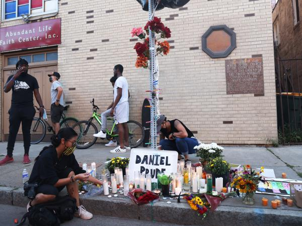 A memorial, pictured in Sept. 2020, commemorated the site where Daniel Prude was arrested in Rochester, N.Y. Prude died of asphyxiation after being restrained by police in March, and his family has filed a wrongful death lawsuit nearly a year later.