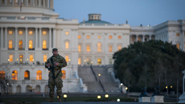 A member of the National Guard patrols outside of the U.S. Capitol on Monday.