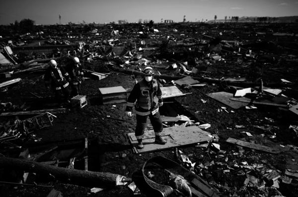 A firefighter stands amid what little remains of the coastal town of Noda, Iwate Prefecture, in northeastern Japan, March 18, 2011. Noda was almost completely destroyed by the earthquake and tsunami.
