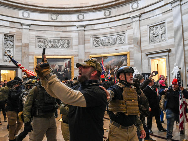 Kenneth Harrelson, identified in an FBI affidavit as the man at center holding a phone in the Capitol Rotunda, is charged with obstructing an official proceeding, destruction of government property, entering a restricted building and conspiracy.