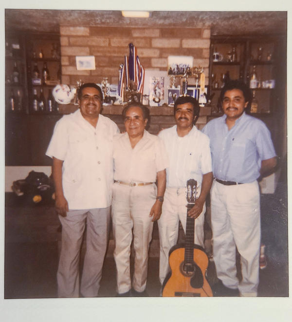 The Aldaco family of Phoenix suffered multiple losses in this year of unfathomable pain. Three brothers perished in the pandemic: Jose (left) in July, Heriberto Jr. (right) in December and Gonzalo (holding guitar) in February. They appear in this undated family photo with their father (second from left).