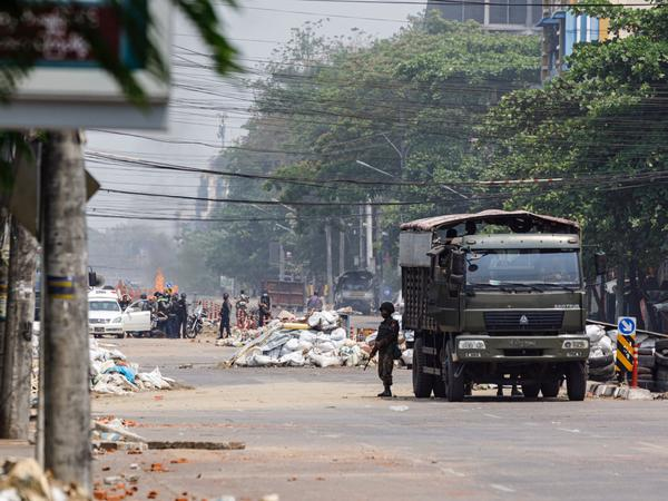 Security forces stand guard on a road as people are arrested, next to dismantled barricades that were set up by protesters demonstrating against the military coup, in Yangon, Myanmar, on Friday.