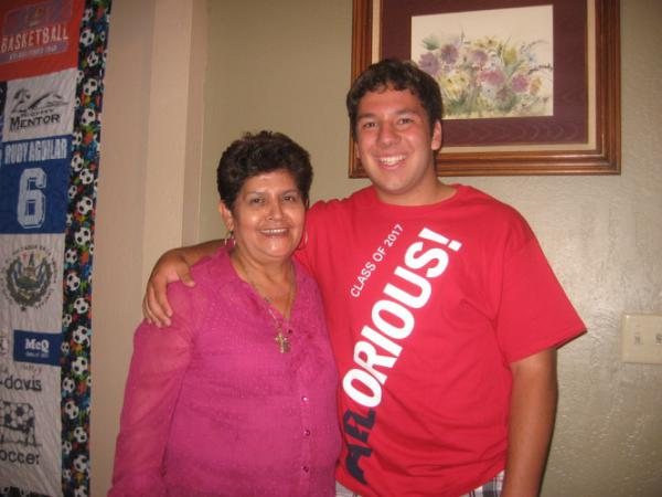 In an early memory, late Belarmina Martinez (left) hugs her nephew Rudy Aguilar.