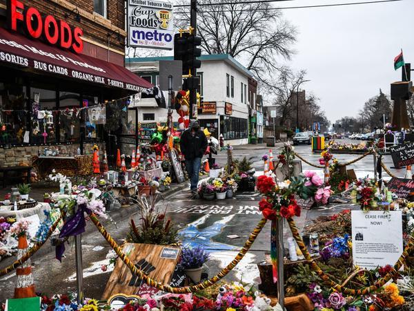 A makeshift memorial in Minneapolis honors George Floyd as jury selection begins in the trial of former police officer Derek Chauvin.