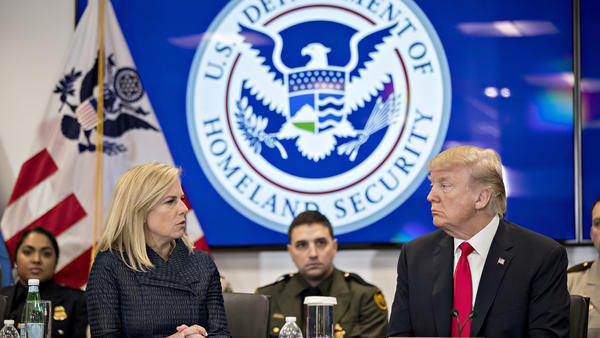 Then-President Donald Trump and the Homeland Security secretary at the time, Kirstjen Nielsen, speak during a Customs and Border Protection roundtable in Virginia in 2018. The Biden administration rescinded an agreement from that time between the Homeland Security and Health and Human Services departments that it says hampered efforts to find safe homes for unaccompanied minors.