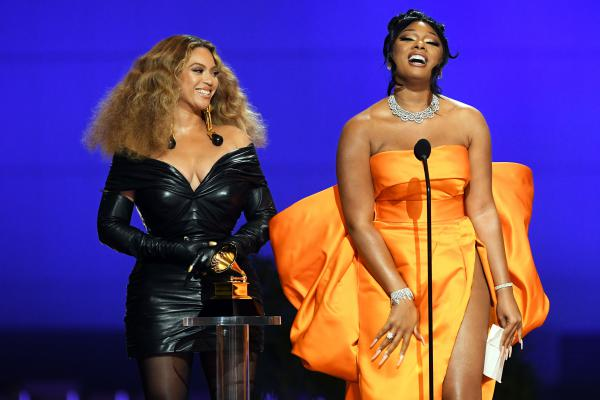 Beyoncé (left) and Megan Thee Stallion, who each won three awards at the 2021 Grammy Awards, accept trophy for best rap performance on March 14, 2021 in Los Angeles, Calif.