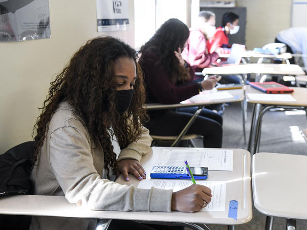 Giani Clarke, 18, a senior at Wilson High School in West Lawn, Pa., takes a test in her AP statistics class earlier this month. The desks are doubled as a way to provide more social distancing.