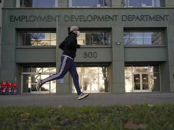 California reported a significant surge in unemployment claims this year for independent contractors, accounting for more than a quarter of all such claims nationally and raising concerns about widespread fraud. Above, a runner passes the office of California's Employment Development Department in Sacramento in December.