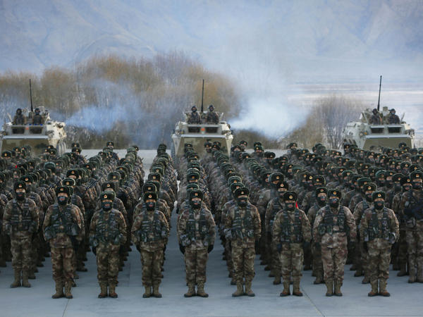 This Jan. 4 photo shows Chinese People's Liberation Army soldiers assembling during military training at Pamir Mountains in Kashgar, northwestern China's Xinjiang region.