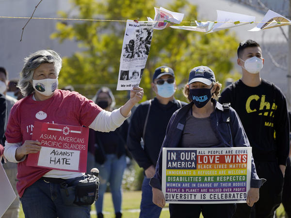 People attend a community rally to raise awareness of anti-Asian violence and racist attitudes, held at Los Angeles Historic Park near the Chinatown district in Los Angeles, Saturday, Feb. 20, 2021.