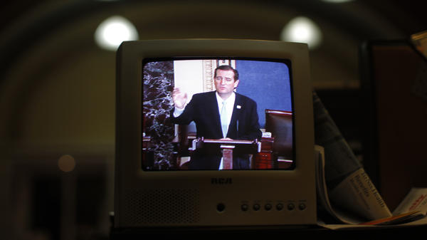 Seen on a TV in the Senate Press Gallery, Sen. Ted Cruz, R-Texas, speaks during the seventh hour of his 2013 filibuster in opposition to the Affordable Care Act. President Biden is advocating for a so-called talking filibuster.