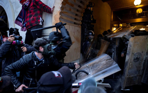 Rioters clash with police and security forces as people try to storm the U.S. Capitol on Jan. 6. The FBI is undertaking an extensive investigation to identify and charge hundreds of individuals.