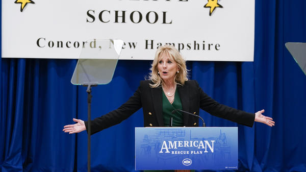 """First lady Jill Biden speaks as she visits the Christa McAuliffe School in Concord, N.H., Wednesday, March 17, 2021, to pay tribute to the New Hampshire woman chosen 35 years ago to be America's """"Teacher in Space"""" and to emphasize that the $1.9 trillion COVID-19 relief plan signed into law by President Joe Biden last week will provide funding for the reopening of schools."""