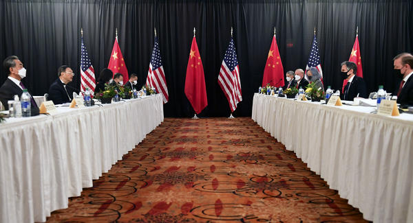 Secretary of State Antony Blinken (second from right), joined by national security adviser Jake Sullivan (right), speaks while facing Chinese Communist Party foreign affairs chief Yang Jiechi (second from left) and China's State Councilor Wang Yi (left) at the opening session of U.S.-China talks at the Captain Cook Hotel in Anchorage, Alaska on Thursday.