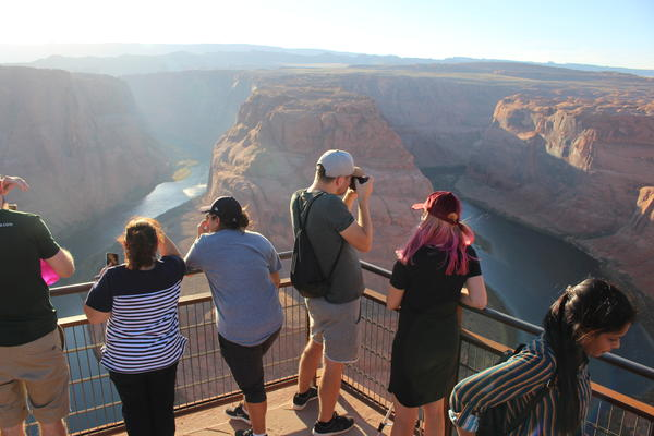 Visitors take in Colorado River views at Horseshoe Bend outside Page, Arizona.
