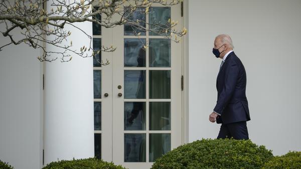President Biden walks to the Oval Office on Wednesday.