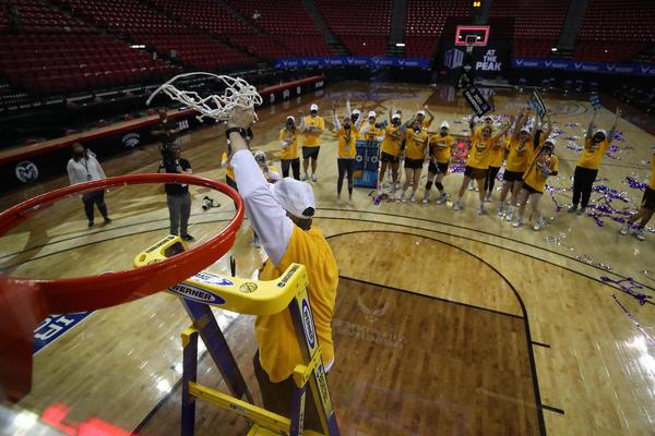 Wyoming's head coach cuts down the game-winning net.